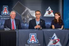 UA President Robert C. Robbins, OSIRIS-REx principal investigator Dante Lauretta and UA senior Keara Burke, an image processing intern on the mission