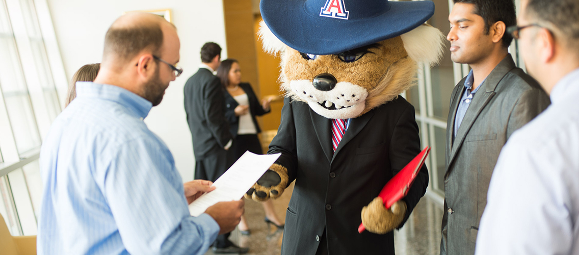 Photo of Wilbur Wildcat networking with recruiters.